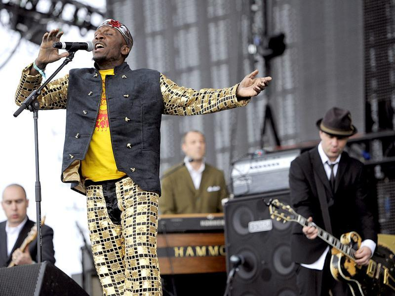 Reggae legend Jimmy Cliff, left, performs onstage with Tim Armstrong, right, during the first weekend of the 2012 Coachella Valley Music and Arts Festival in Indio, California. AP Photo/Chris Pizzello