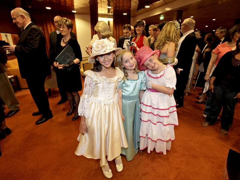 Passengers in costumes and evening dress arrive to a reception prior to the gala dinner in the MS Balmoral Titanic memorial cruise ship, in the Atlantic Ocean. AP Photo/Lefteris Pitarakis