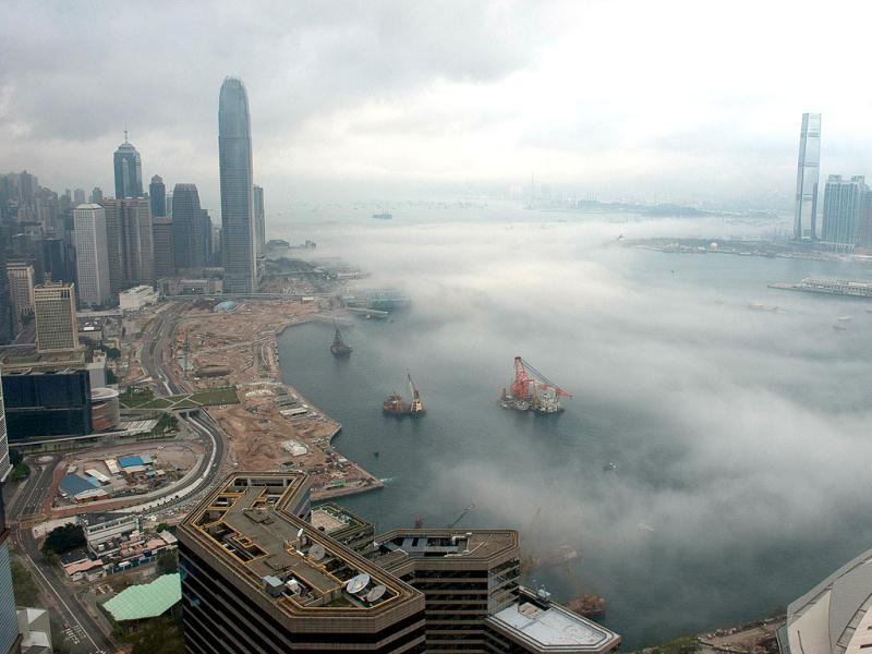 Morning fog rises off Victoria Harbor in Hong Kong. AFP Photo/ Antony Dickson