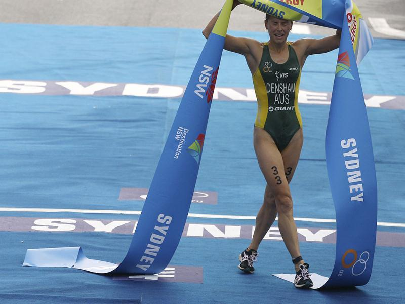 Australia's Erin Densham crosses the finish to win the elite women race at the ITU World Triathlon Series in Sydney. AP Photo/Rick Rycroft