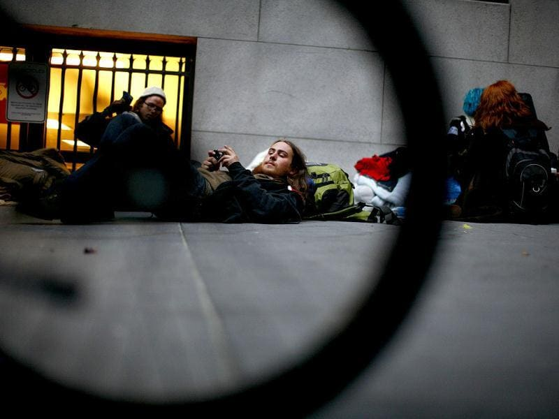 Protesters with the Occupy Wall Street movement sit and lie on the sidewalk in front of the New York Stock Exchange in New York. Reuters photo/Eric Thayer