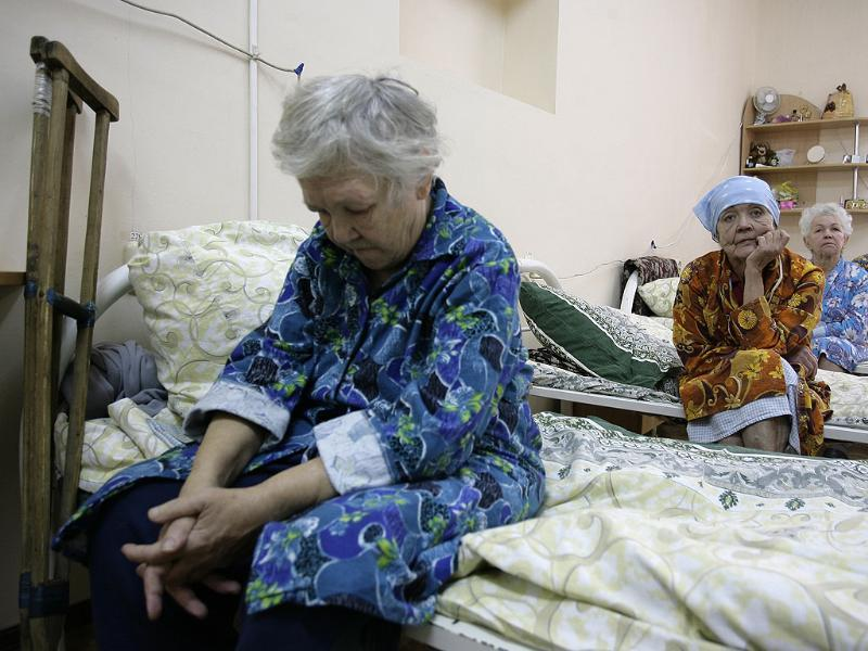 Women sit on their beds at a regional center to provide social aid to homeless people in Russia's city of Rostov-on-Don. Reuters/Vladimir Konstantinov