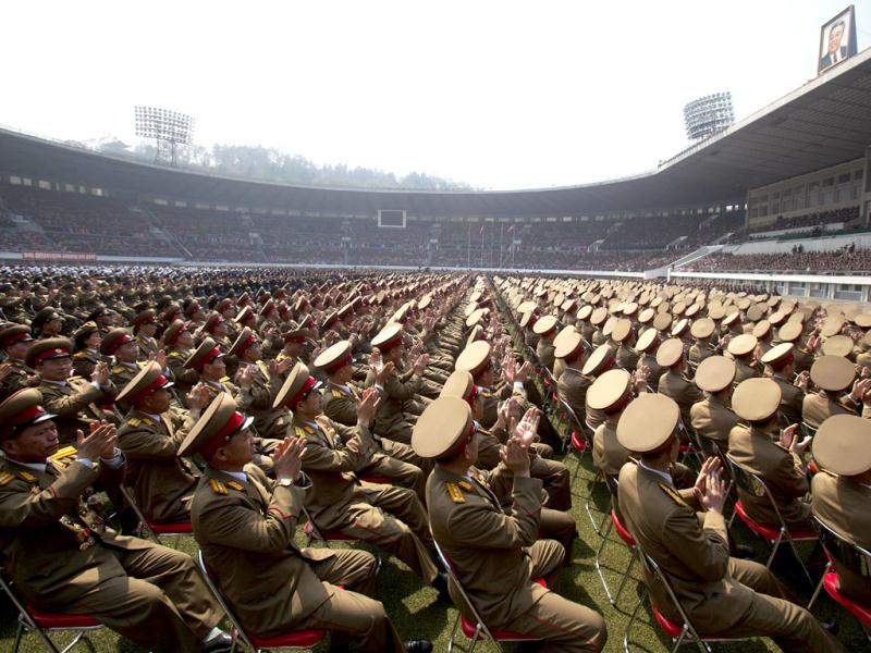 A crowd of North Korean military members look up to a stadium podium and applaud the country's leader Kim Jong Un and senior military and government officials during a meeting of the Central Committee of North Korea's ruling party in Pyongyang. AP Photo/David Guttenfelder