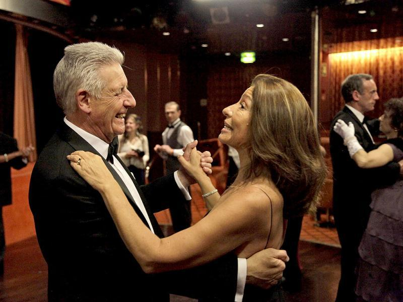 Passengers dance during a reception prior to the gala dinner in the MS Balmoral Titanic memorial cruise ship. 100 years after the Titanic went down, the cruise with the same number of passengers aboard is setting sail to retrace the ship's voyage. AP Photo/Lefteris Pitarakis