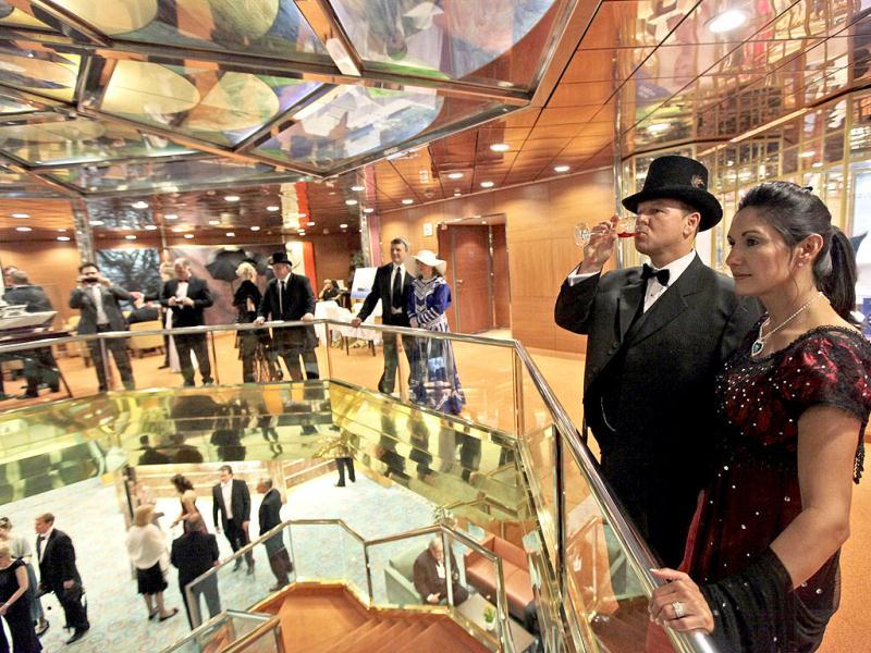 Passengers walk around the MS Balmoral Titanic memorial cruise ship, prior to the gala dinner in the Atlantic Ocean. The Titanic Memorial Cruise will commemorate the 100th anniversary of the sinking of the White Star liner on April 15, 2012. AP Photo/Lefteris Pitarakis
