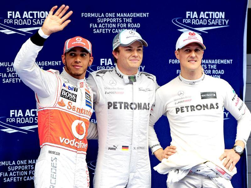 Mercedes-AMG driver Nico Rosberg of Germany (C), McLaren-Mercedes driver Lewis Hamilton of Britain (L) and Mercedes-AMG driver Michael Schumacher of Germany (R) celebrate after the qualifying session of Formula One's Chinese Grand Prix at the Shanghai International Circuit. AFP/ Mark Ralston