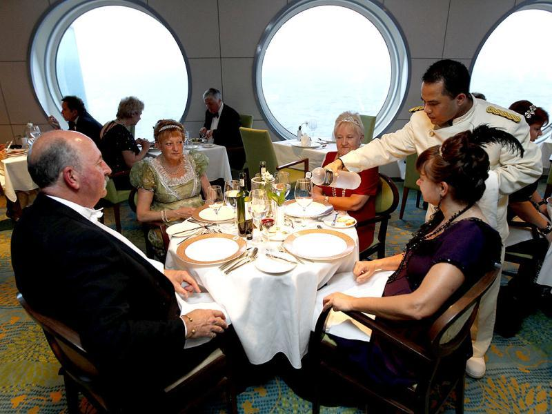 Passengers are served dinner on board the Titanic memorial cruise ship in the mid-Atlantic Ocean. The cruise is retracing the voyage from Southampton of the ill-fated Titanic liner, which hit an iceberg and sank 100 years ago on April 15, 1912. Reuters Photo/Chris Helgren