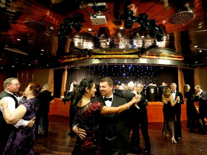 Passengers dance during a reception on board the Titanic memorial cruise ship in the mid-Atlantic Ocean. The cruise is retracing the voyage from Southampton of the ill-fated Titanic liner, which hit an iceberg and sank 100 years ago on April 15, 1912. Reuters Photo/Chris Helgren