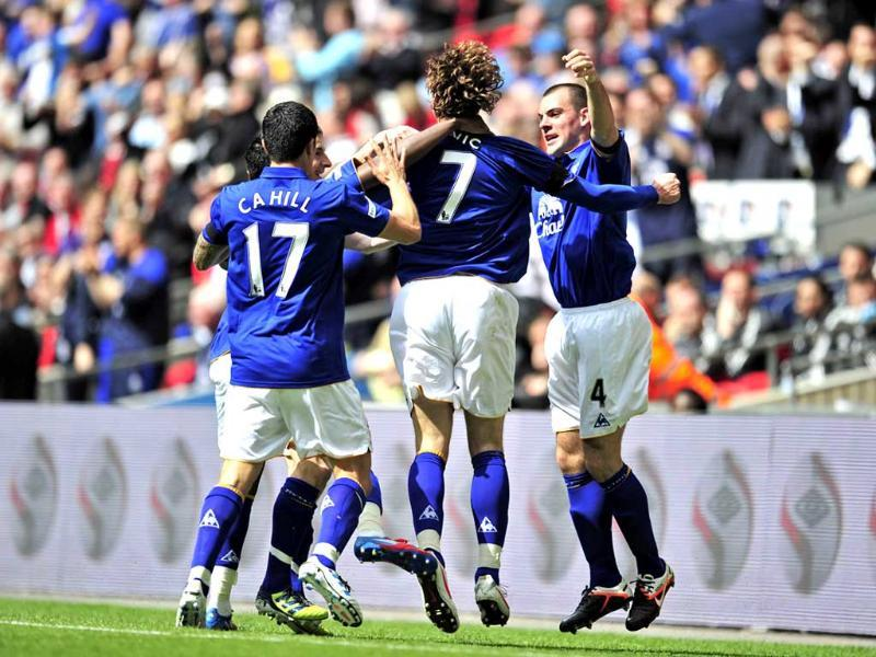 Everton striker Nikica Jelavic (2nd R) celebrates scoring the opening goal with teammates during the FA Cup semifinal football match against Liverpool at Wembley Stadium in London, England. AFP Photo/Glyn Kirk