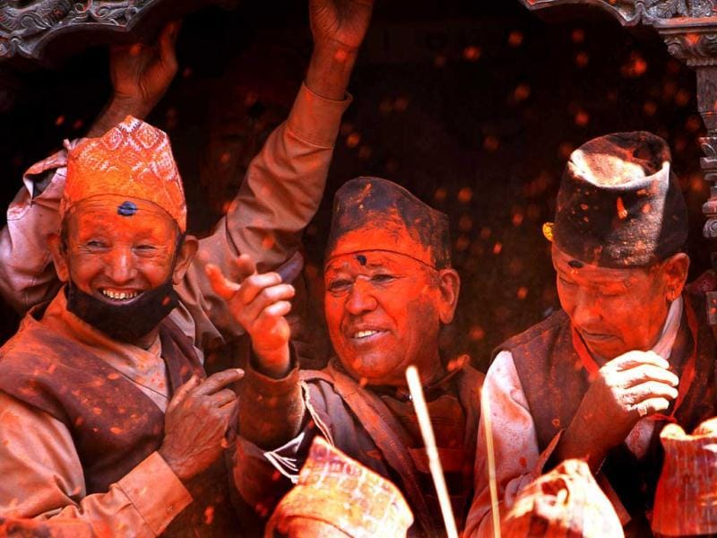 Nepalese devotees smeared with vermilion powder participate in Sindur Jatra festival in Thimi, on the outskirts of Katmandu, Nepal. Sindur Jatra, or Vemillion Powder Festival, is celebrated to welcome the advent of spring and the New Year. (AP Photo/Niranjan Shrestha)