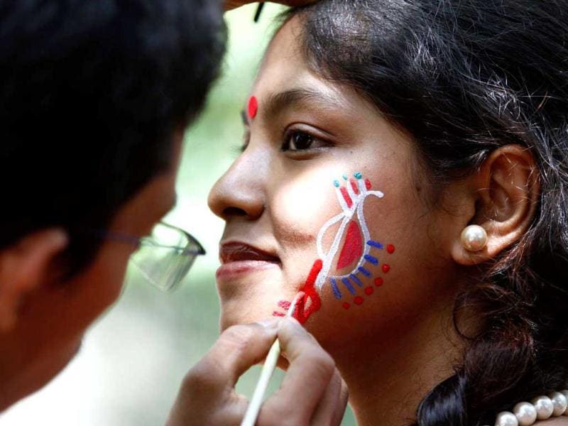 A girl gets her face painted during a celebration of 'Poila Baishakh', the first day of Bengali new year in Dhaka. Reuters photo