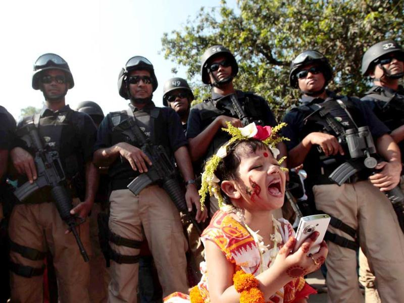 A child cries as members of Special Weapons And Tactics (SWAT) team stand guard during a celebration of 'Poila Baishakh', the first day of Bengali new year in Dhaka. Reuters photo