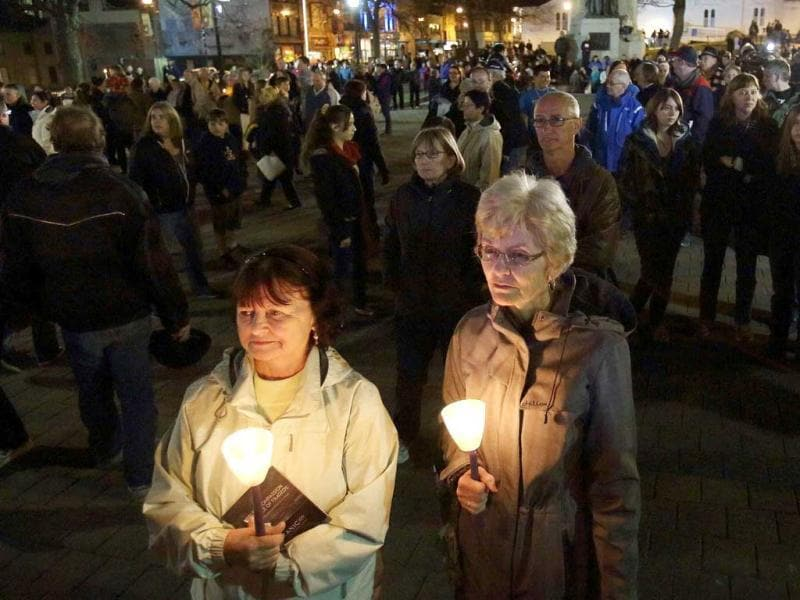 Two women hold candles as they watch an interpretive presentation commemorating the100th anniversary of the sinking of the Titanic at the Grand Parade in Halifax, Nova Scotia. Reuters/Paul Darrow