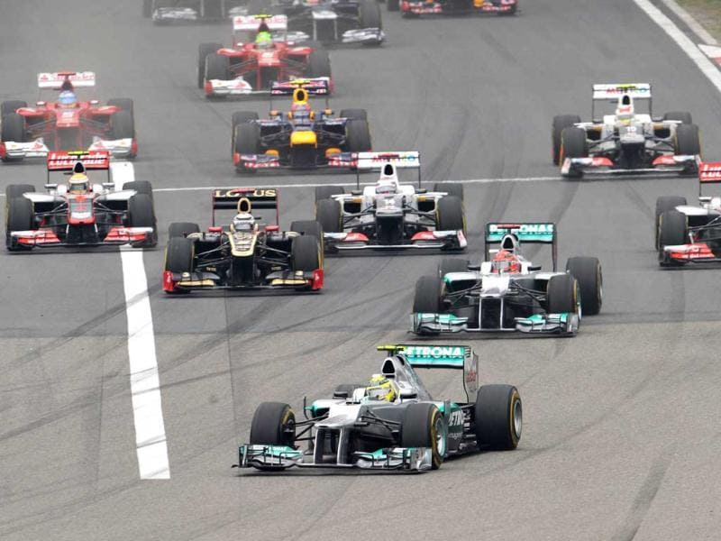 Nico Rosberg leads his teammate Michael Schumacher and other cars during the start of Chinese Grand Prix in Shanghai. (AFP Photo/Liu Jin)