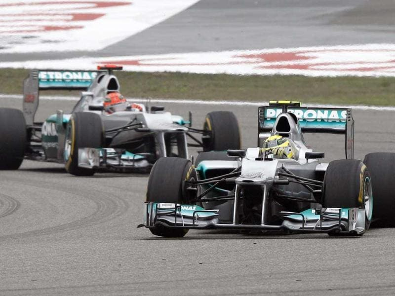 Nico Rosberg leads teammate and compatriot Michael Schumacher into turn two at the start of the Chinese Formula One Grand Prix in Shanghai. (AP Photo/Mark Baker)