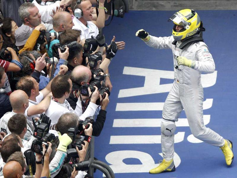 Nico Rosberg of Germany celebrates with his team after winning the Chinese Formula One Grand Prix in Shanghai. (AP Photo/Mark Baker)