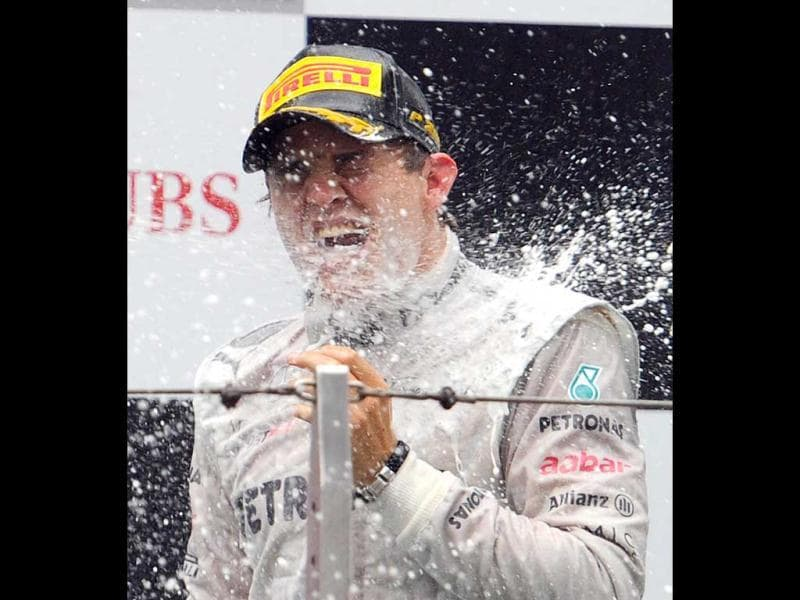 Winner Mercedes-AMG driver Nico Rosberg of Germany is sprayed with champagne on the podium during the awards ceremony after the finish of Formula One's Chinese Grand Prix at the Shanghai International Circuit . (AFP Photo/Liu Jin)