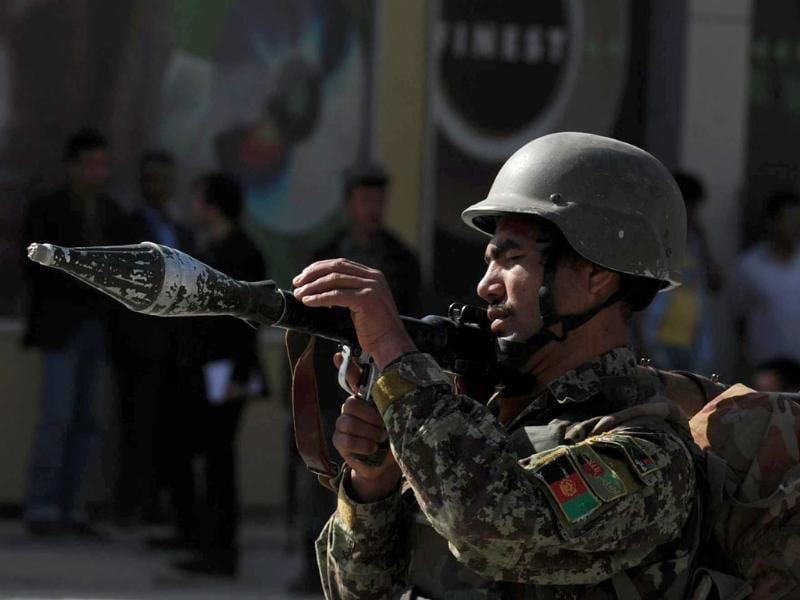 An Afghan National Army soldier holds a rocket-propelled grenade launcher near the scene of an attack in Kabul. AFP/Shah Marai