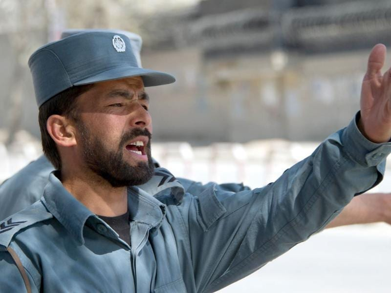 Afghan police gesture near the scene of an attack in Kabul. AFP/Johannes Eisele