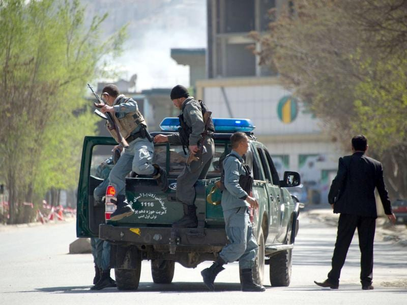 Afghan police head to the scene of an attack in Kabul. AFP/Johannes Eisele