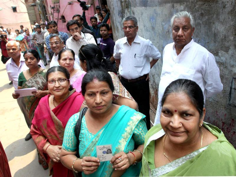 Voters wait for their turn to cast votes at a polling booth in Kinari Bazar during MCD elections in New Delhi. PTI/Atul Yadav