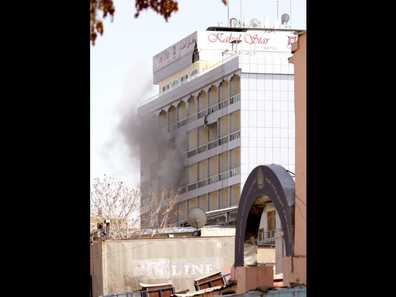 Smoke rises from a hotel after it was hit by a rocket-propelled grenade in Kabul, Afghanistan. AP photo