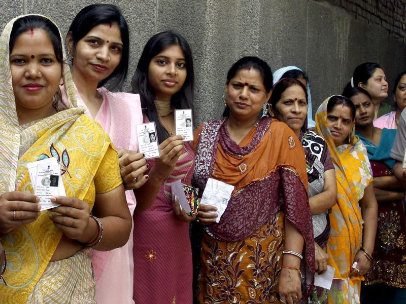 Voters wait in line for their turn to cast votes at a polling booth in Mauj Pur, northeast Delhi. HT Photo by Sonu Mehta