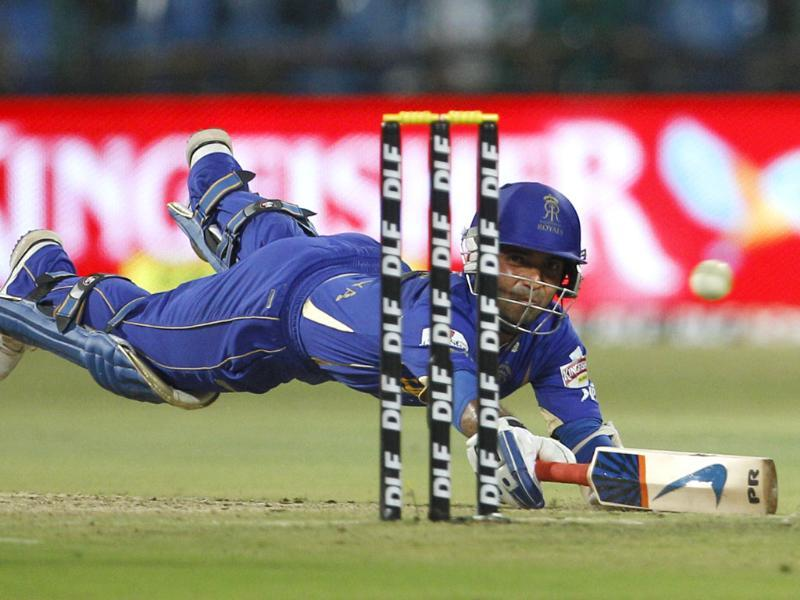 Rajasthan Royals batsman Ajinkya Rahane dives to successfully make it to the crease during their Indian Premier League (IPL) cricket match against Royal Challengers Bangalore in Bangalore. AP/Aijaz Rahi