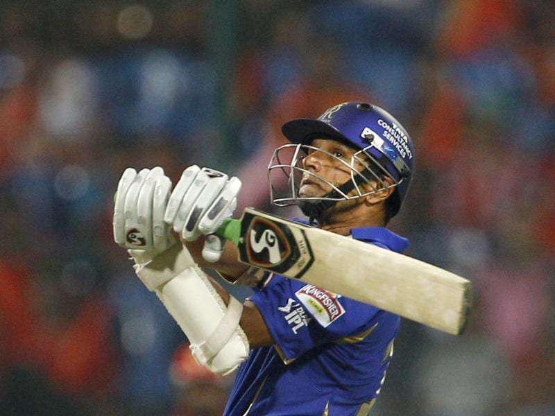 Rajasthan Royals captain Rahul Dravid watches his shot during their Indian Premier League (IPL) cricket match against Royal Challengers Bangalore in Bangalore. AP/Aijaz Rahi