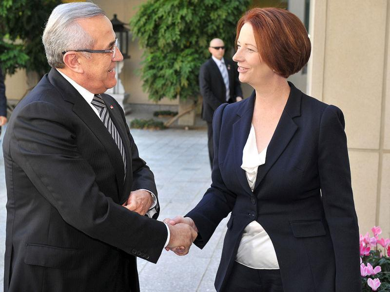 Lebanon's President Michel Suleiman is welcomed by Australian Prime Minister Julia Gillard at Parliament House in Canberra, Australia. (AP Photo/Mark Graham)