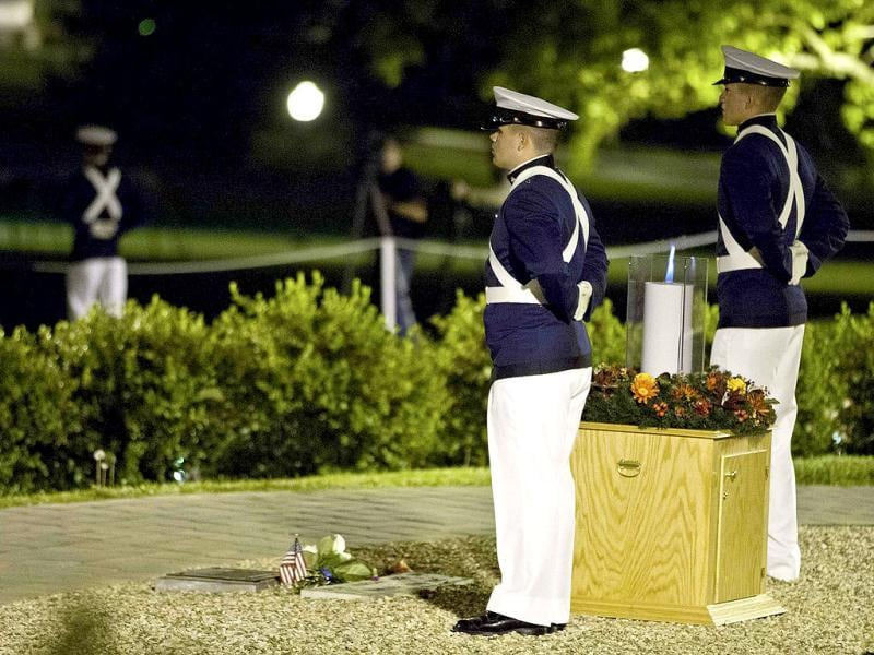 Two Virginia Tech cadets stand at attention next to a candle lit in remembrance on the campus of Virginia Tech in Blacksburg, North Carolina. (Reuters/Chris Keane)