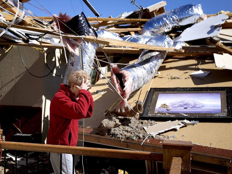 Carole Beckett reacts as she sorts through belongings at her home after a tornado moved through Woodward, Oklahoma. (AP Photo/Bryan Terry)