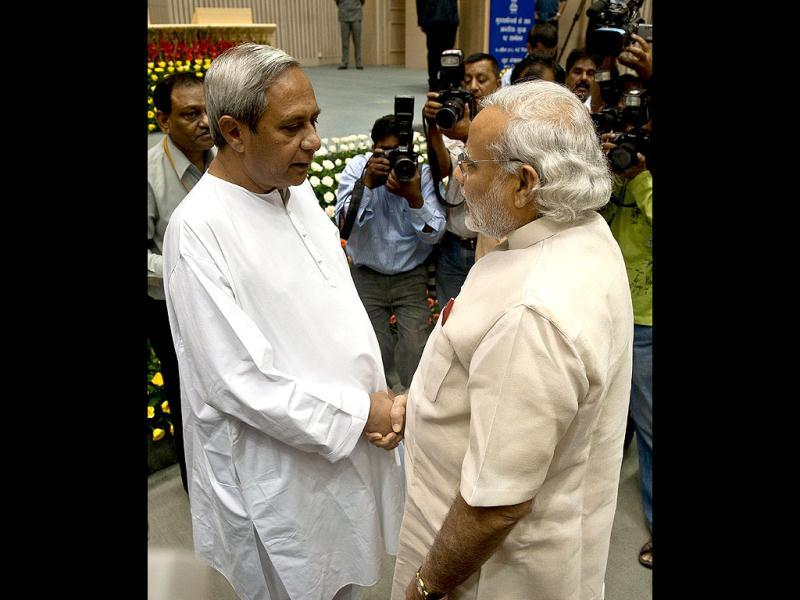 Odisha chief minister Naveen Patnaik shakes hands with Gujarat chief minister Narendra Modi during a meeting of chief ministers on internal security in New Delhi. (AFP Photo/Prakash Singh)