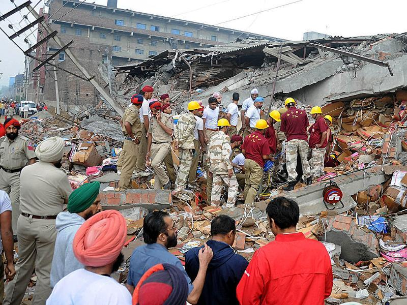 NDRF Team and local police undertaking rescue operations after a four storey building collapsed in Jalandhar. (Agencies)
