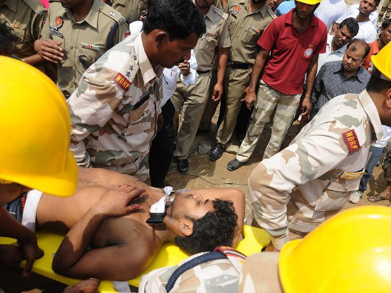 NDRF Team rushing a labourer to hospital during rescue operation after a four storey building collapsed in Jalandhar. (Agencies)
