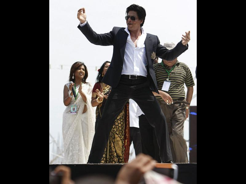 SRK plays to the gallery as he performs at the ceremony.