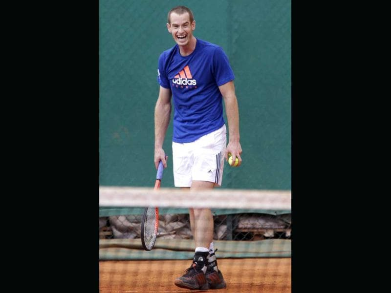 Andy Murray from Great Britain reacts during a training session of the Monte Carlo Tennis Masters tournament in Monaco. AP Photo/Lionel Cironneau