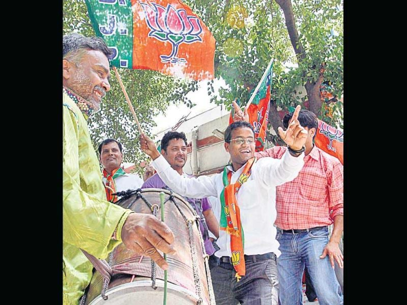 BJP workers celebrate the party's win on Tuesday. Arvind Yadav/HT photo