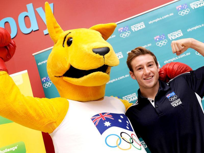 Australia's Beijing 2008 Olympic diving gold medallist Matt Mitcham (R) poses with the Boxing Kangaroo as the Australian Olympic Committee (AOC) in Sydney marks 100 days until the opening ceremony of the London 2012 Olympic Games. (AFP photo/ William West)