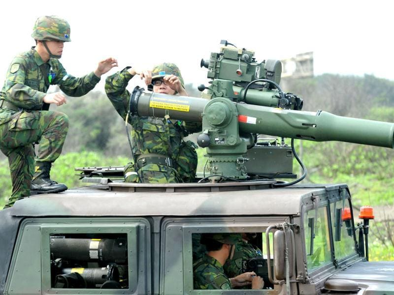 Taiwanese soldiers man mobile launchers of the US-made TOW anti-tank missiles during a drill held in the northern Taoyuan county. (AFP photo/ Mandy Cheng)
