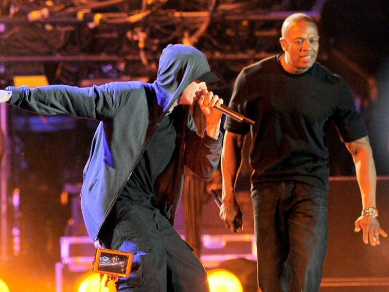 Eminem, left, performs with Dr. Dre during the headlining performance by Dre and Snoop Dogg on the first weekend of the 2012 Coachella Valley Music and Arts Festival in Indio, Calif. (AP Photo/Chris Pizzello)