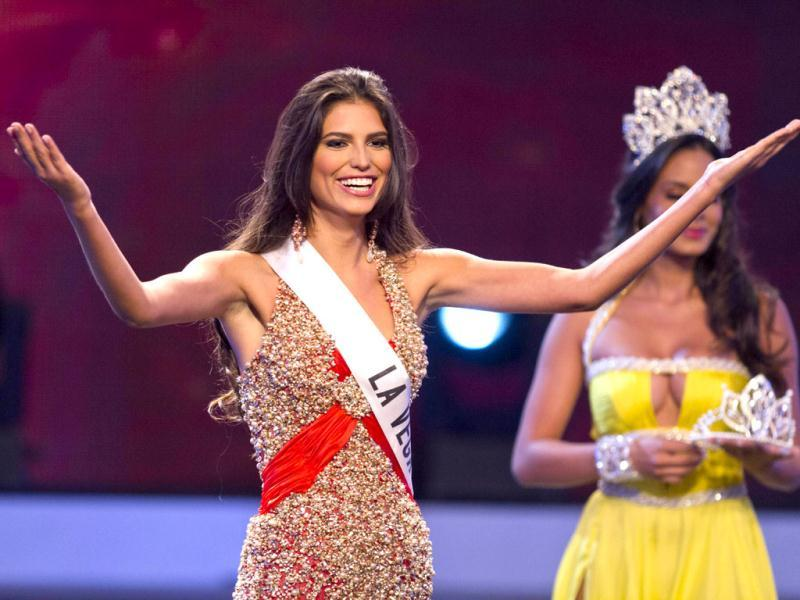 Carlina Duran, 25, reacts after being crowned Miss Dominican Republic 2012 in Santo Domingo. Duran will represent the country in the Miss Universe competition. (AFP photo/ Erika Santelices)