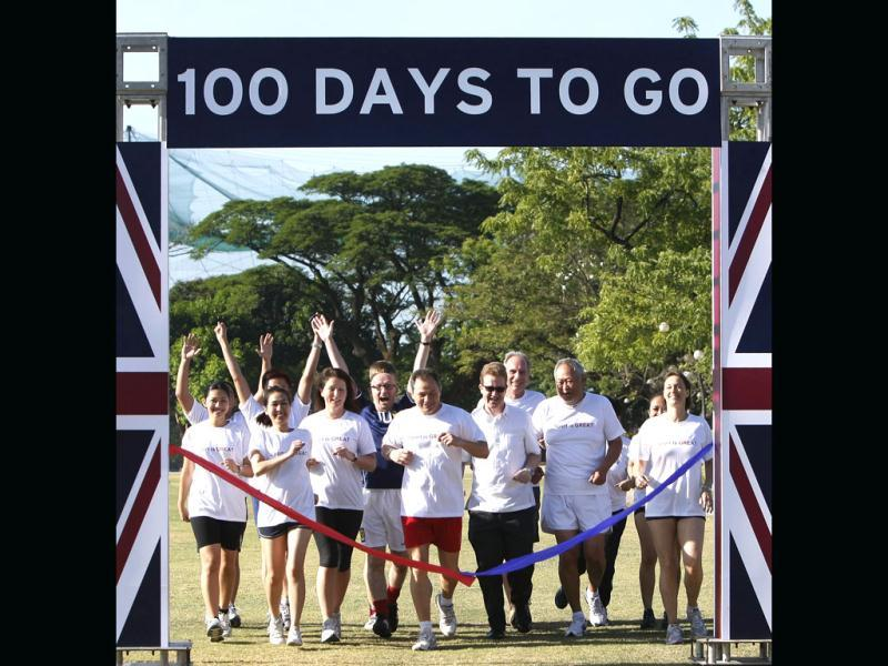 British and Filipino embassy staff, led by British Ambassador to the Philippines Stephen Lillie, third from right, front row, make the ceremonial 100m race to mark the 100 days countdown to the 2012 London Olympics at the financial district of Makati city east of Manila, Philippines. (AP Photo/Bullit Marquez)