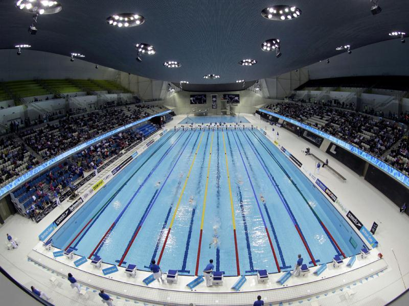 This photo shows swimmers competing in the men's 1500 meter freestyle during the British Swimming Championship selection trials and Olympic test event at the London 2012 Olympic Aquatics Centre at the Olympic Park in London. (AP Photo/Sang Tan, File)