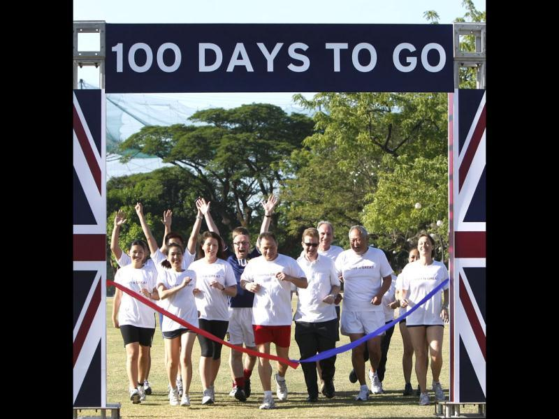British and Filipino embassy staff, led by British Ambassador to the Philippines Stephen Lillie, third from right, front row, make the ceremonial 100m race to mark the 100 days countdown to the 2012 London Olympics. (AP Photo/Bullit Marquez)