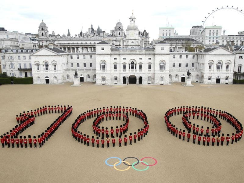 In this photo issued by London 2012 London Organizing Committee of the Olympic and Paralympic Games (LOCOG), 260 Guardsmen from the Grenadier, Coldstream, Scots and Welsh Guards mark 100 days before the London 2012 Olympic Games at Horse Guards Parade in central London. The opening ceremony will take place on July 27, 2012. (AP Photo/LOCOG)