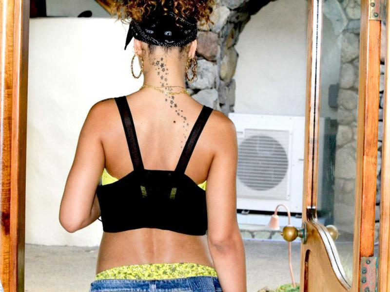 Rihanna shows off her tattoo.