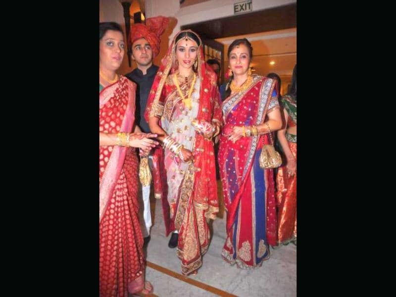 Bride Taneesha Verma looks beautiful in a red traditional attire.