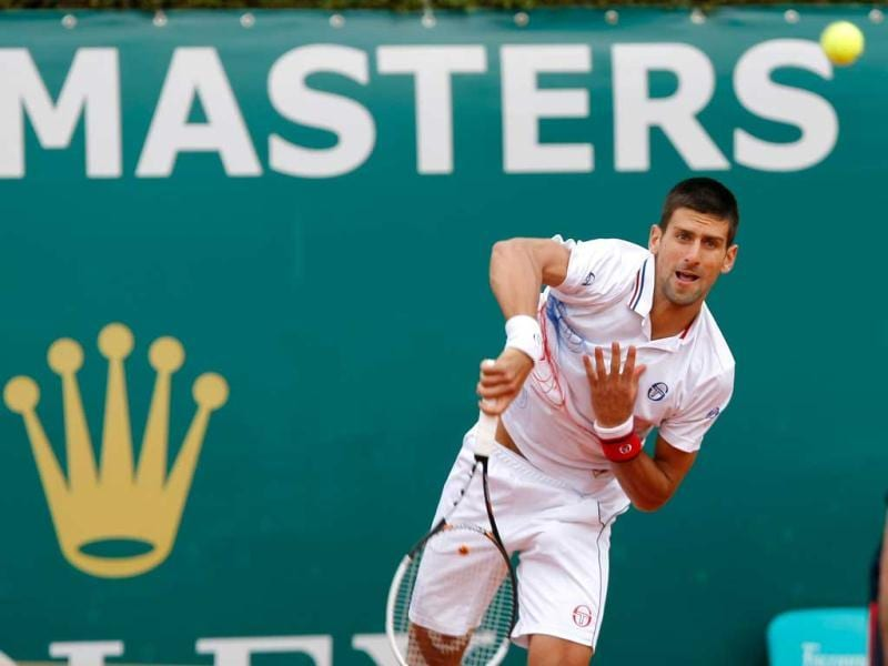 Serbia's Novak Djokovic serves the ball to Italy's Andreas Seppi during their match of the Monte Carlo Tennis Masters tournament in Monaco. AP Photo/Claude Paris