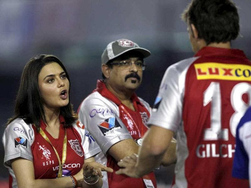 Kings XI Punjab co-owner Preity Zinta reacts as Adam Gilchrist looks on, in a dug-out during the IPL-5 match against Kolkata Knight Riders in Mohali. PTI Photo/Aman Sharma